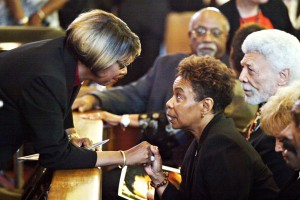 An unidentified mourner, left, greets Oakland, Congresswoman Barbara Lee at the funeral of long-time Bay Area journalist Chauncey Bailey Aug. 8, 2007, in Oakland. (D. Ross Cameron/The Oakland Tribune)