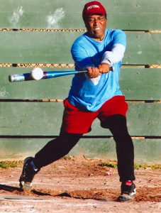 Chauncey Bailey gets a hit during a softball game with the Newshounds in Oakland June 24, 2004 (Ray Chavez/OaklandTribune)